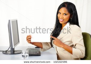 stock-photo-portrait-of-a-friendly-young-executive-lady-at-work-while-show-a-white-card-102162586