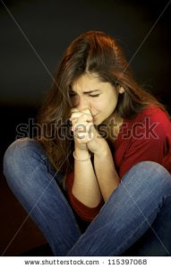 stock-photo-scared-young-woman-crying-and-praying-115397068