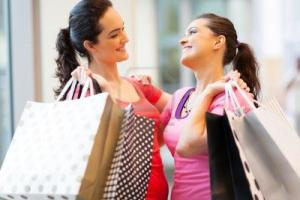 15402596-happy-friends-shopping-in-mall