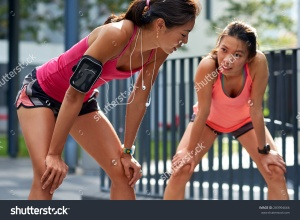 stock-photo-exhausted-sporty-asian-chinese-women-runners-after-fitness-running-workout-outdoors-283994666